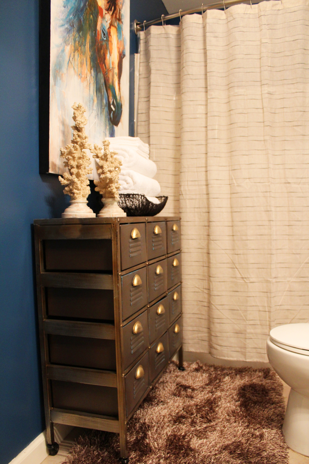 eclectic, blue guest bathroom