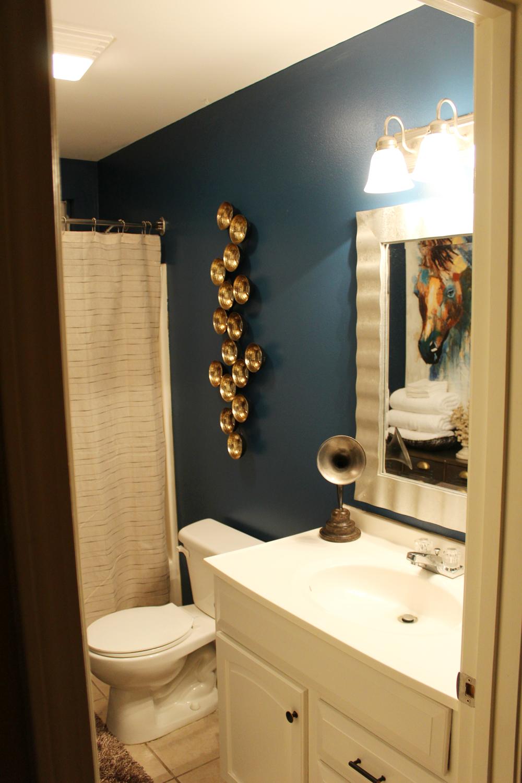 eclectic, blue guest bathroom