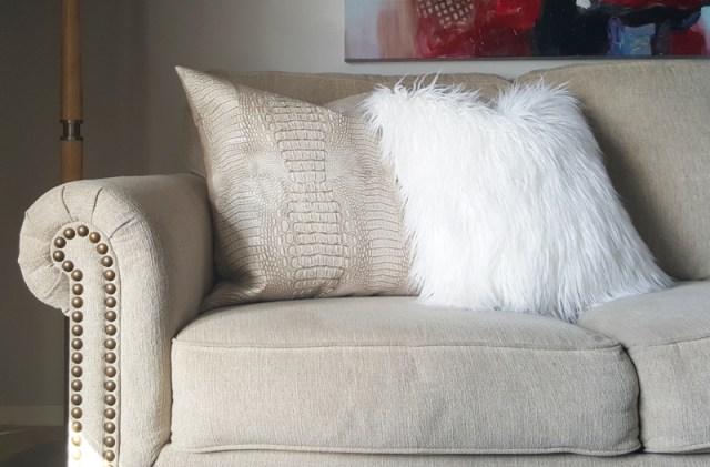 faux leather pillow and white faux fur pillow via whitneyjdecor.com