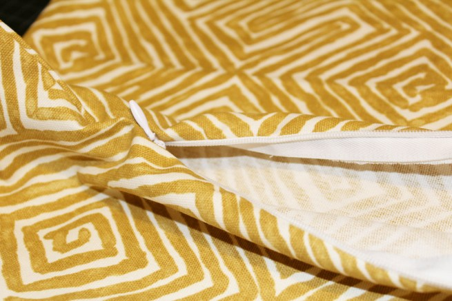 mustard geometric pillow