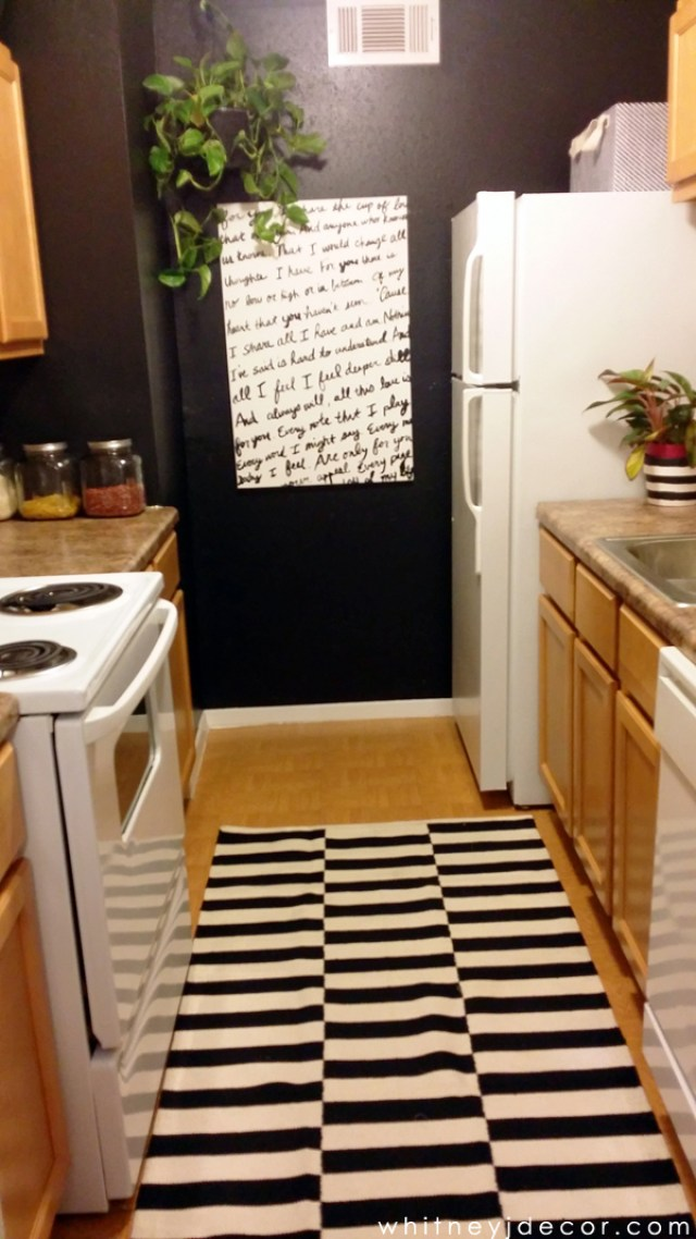 decor of small, galley apartment kitchen - after