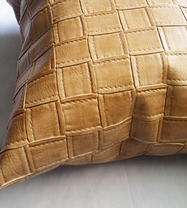 tan faux leather pillow