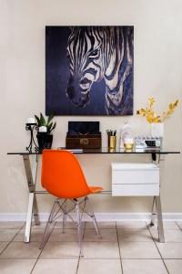 neutral living room | zebra art | home office | home office in living room | desk in living room | chrome desk | glass desk | orange desk chair | britt smith photography