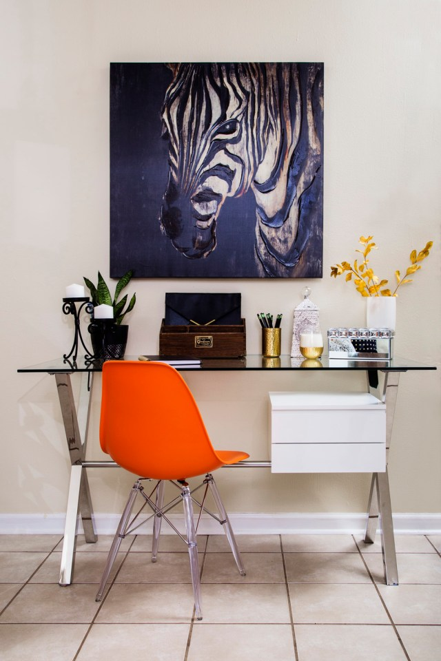 neutral living room | zebra art | home office | home office in living room | desk in living room | chrome desk | glass desk | orange desk chair | britt smith photography