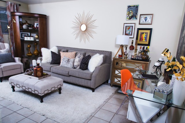neutral living room | cream recliner | gold studs pillow | leather bookcase | neutral with pop of orange | eclectic bar cart | britt smith photography