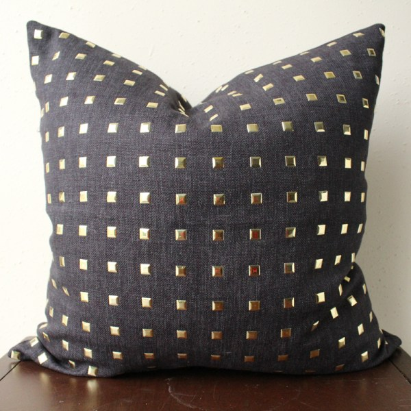 black gold studded pillow