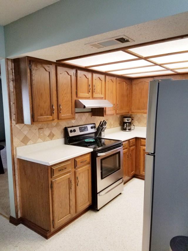 whitney j decor | kitchen before | white kitchen decor | one room challenge