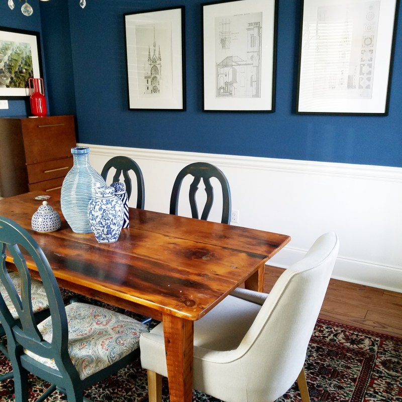 whitney j decor | transitional dining room | blue dining room walls | dark blue walls | sherwin williams endless sea paint | vintage red rug and blue walls in dining room