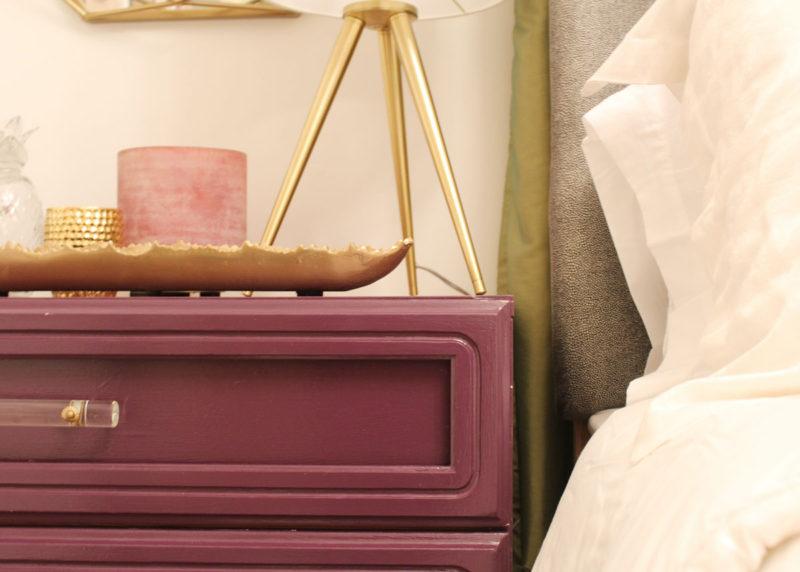 purple dresser and gold geometric mirror