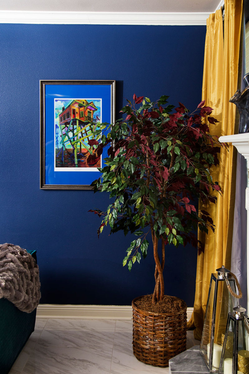 blue walls and faux tree