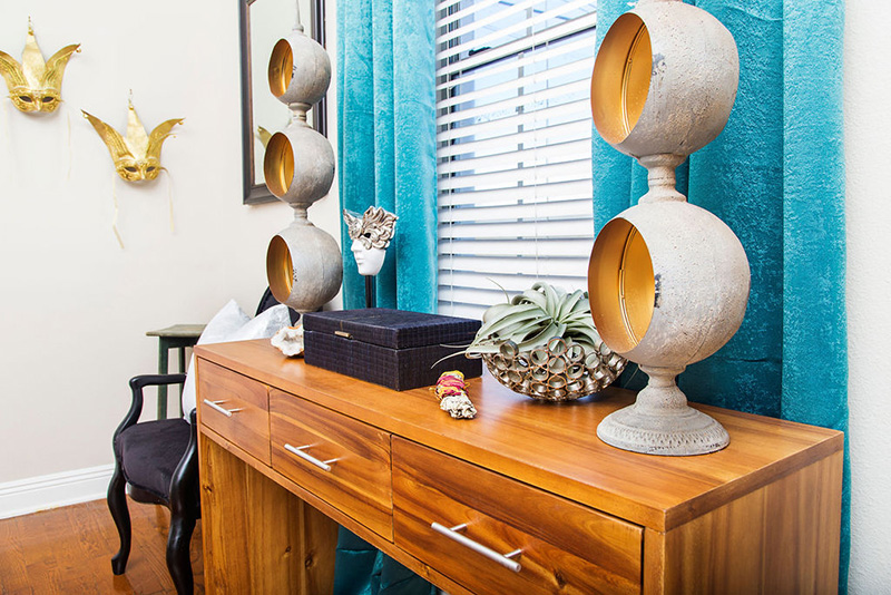 wood console table and teal curtains