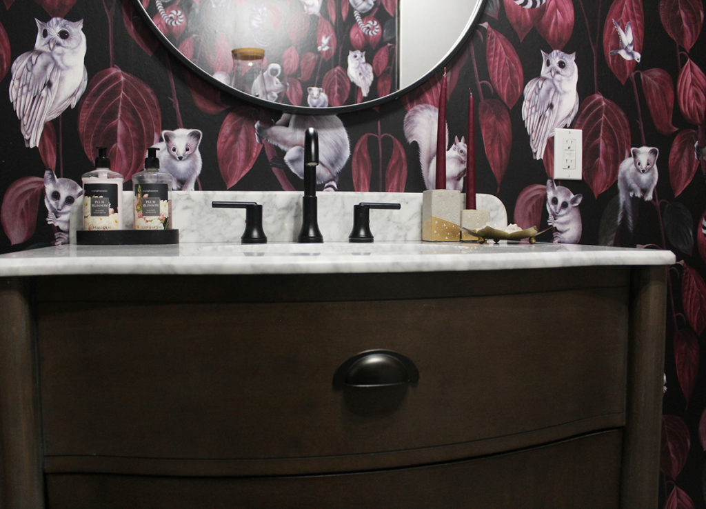 bold wallpaper and brown vanity