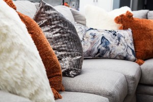 neutral living room with orange accents 11