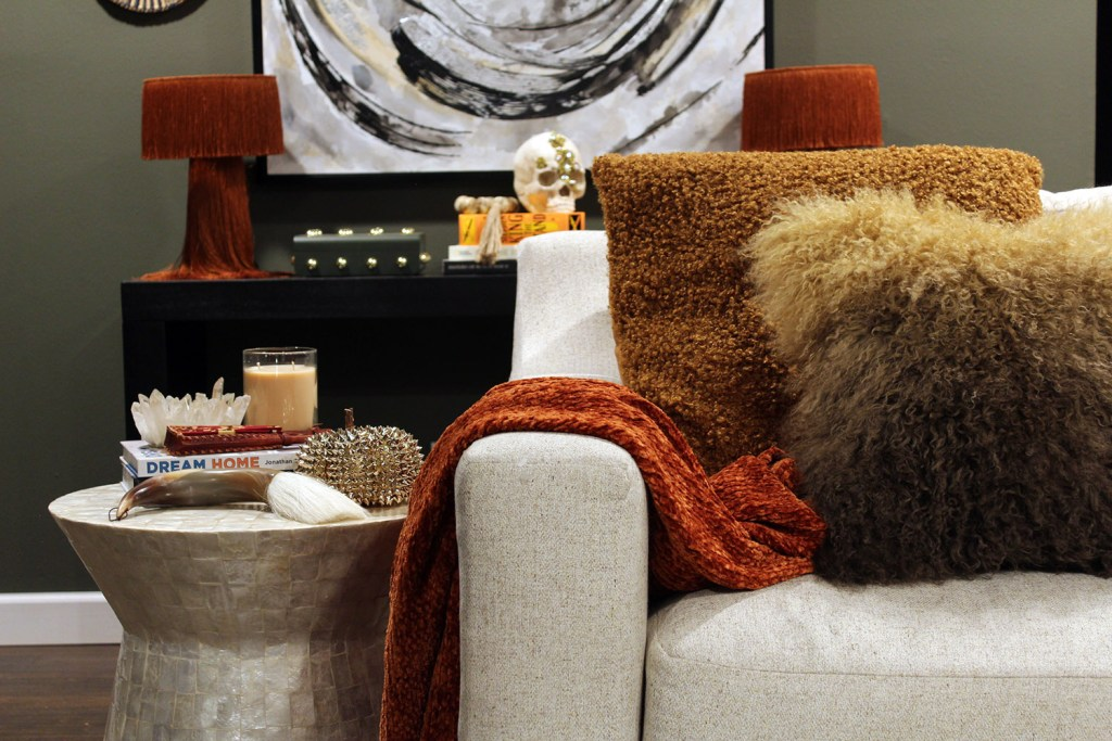 fall decor inspiration - burnt orange throw with capiz table and black table and white art in the background