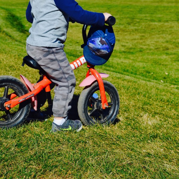 My little fearless one riding his balance bike down the hill.