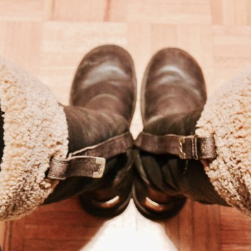 Brown leather tall boots with light beige fur on the tops.