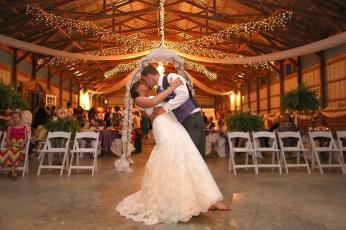 Wedding kiss inside barn