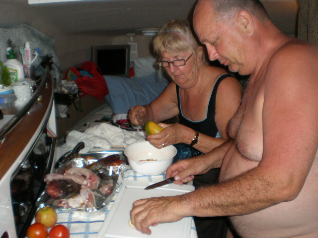 Rod and Val preparing the fish