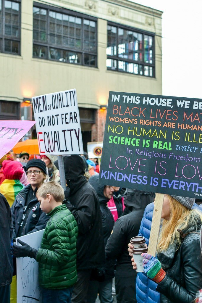 women march protest signs