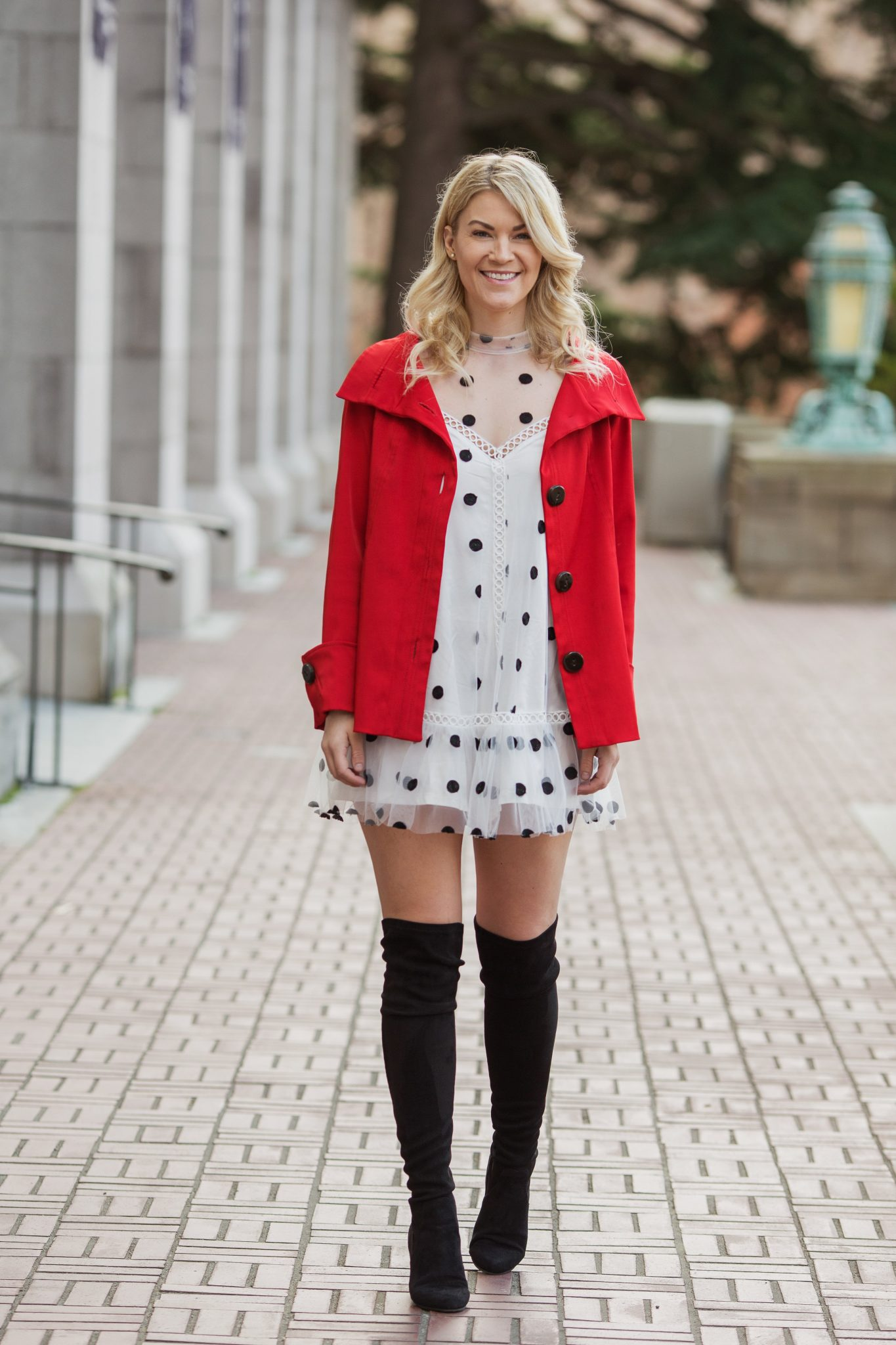 red raincoat otk boots polka dots
