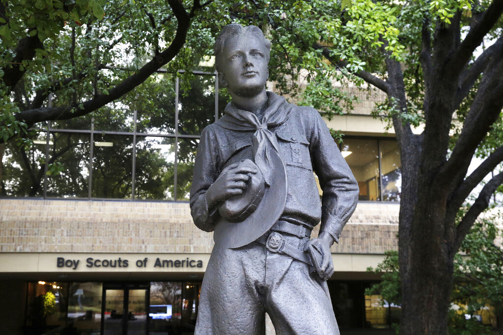 In this Wednesday, Feb. 12, 2020, photo, a statue stands outside the Boys Scouts of America headquarters in Irving, Texas. The Boy Scouts of America has filed for bankruptcy protection as it faces a barrage of new sex-abuse lawsuits. The filing Tuesday, Feb. 18, in Wilmington, Delaware, is an attempt to work out a potentially mammoth compensation plan for abuse victims that will allow the 110-year-old organization to carry on.
