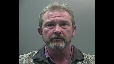 A former member of the Limestone County Commission was arrested Monday night.