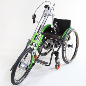 A green attachment that attaches to a wheelchair to convert it into a three-wheeled cycle.