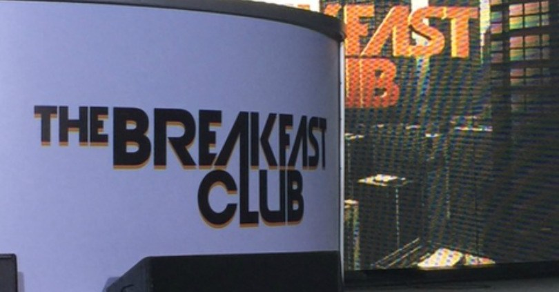 Panel with The breakfast club sign with a backdrop that says breakfast club