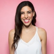 pink background girl smiling with pink lipstick