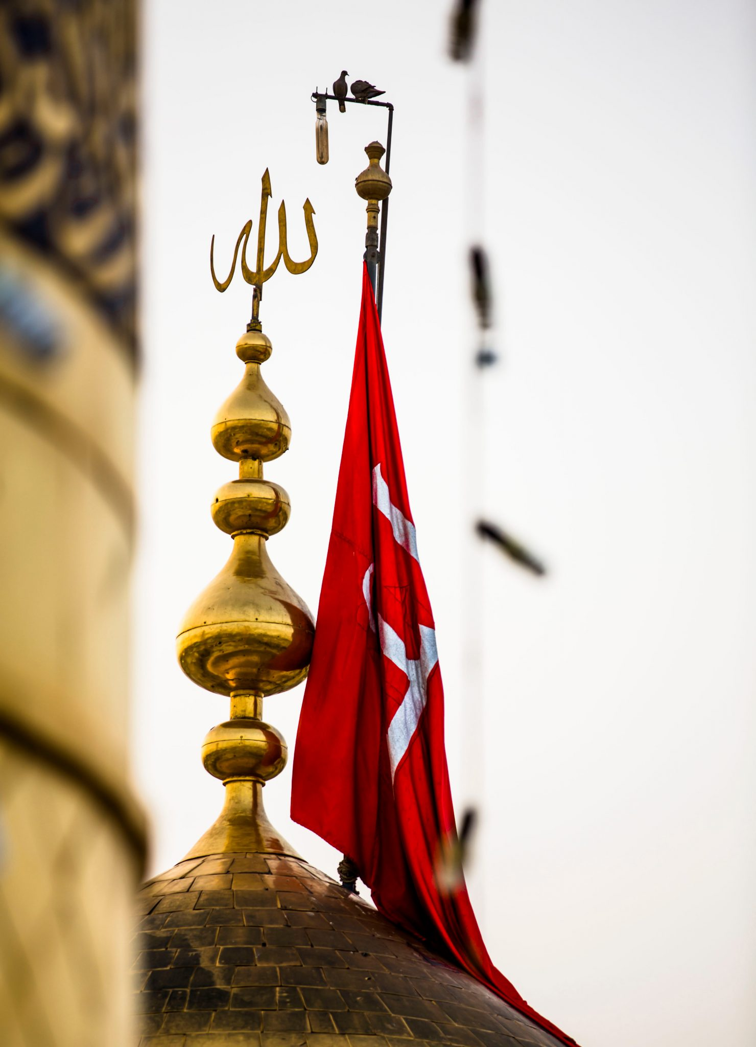The flag pole on the dome of Hussain's shrine