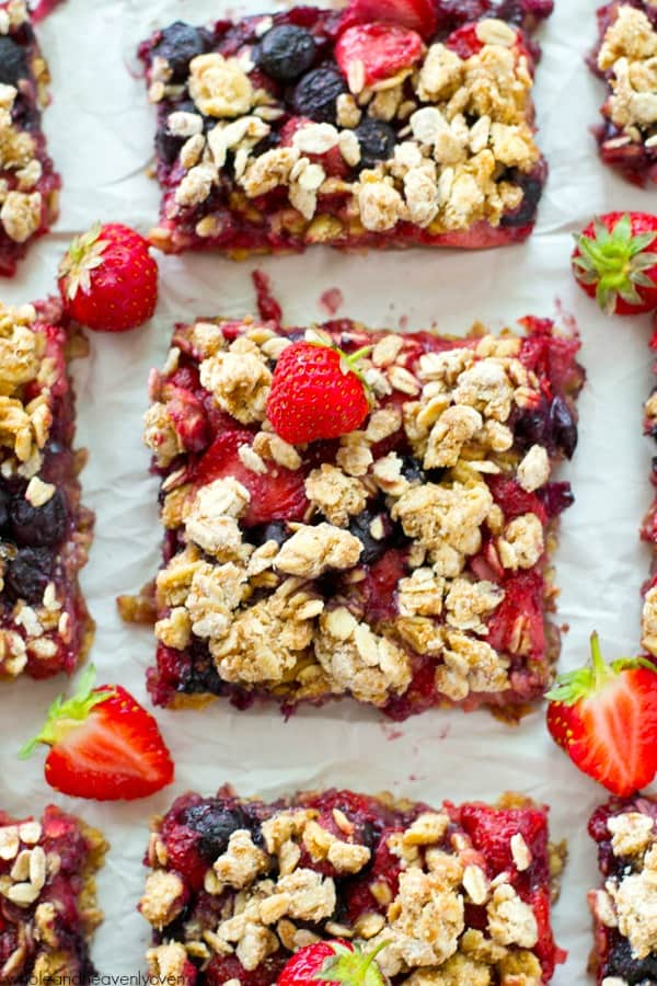 Loaded with a double-delight of juicy berries and topped with lots of buttery oat streusel, these patriotic crumb bars make a super-easy, yet very impressive 4th of July dessert! @WholeHeavenly