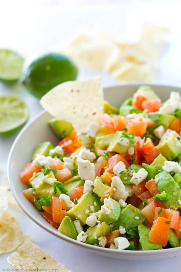 Unbelievably fresh-tasting and loaded with a plethora of flavorful greek ingredients, this easy chunky-style guacamole will quickly become your gotta-have summer appetizer!