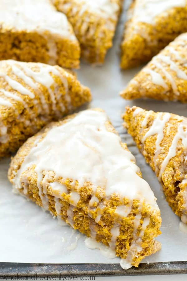 Learn how to make coffee shop-style pumpkin spice scones at home with this easy recipe! They're perfect alongside a cup of coffee. @WholeHeavenly