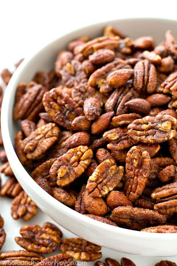 Roasted to perfection in maple syrup and spices, these candied pecans and almonds make the ultimate holiday snack or gift! @WholeHeavenly