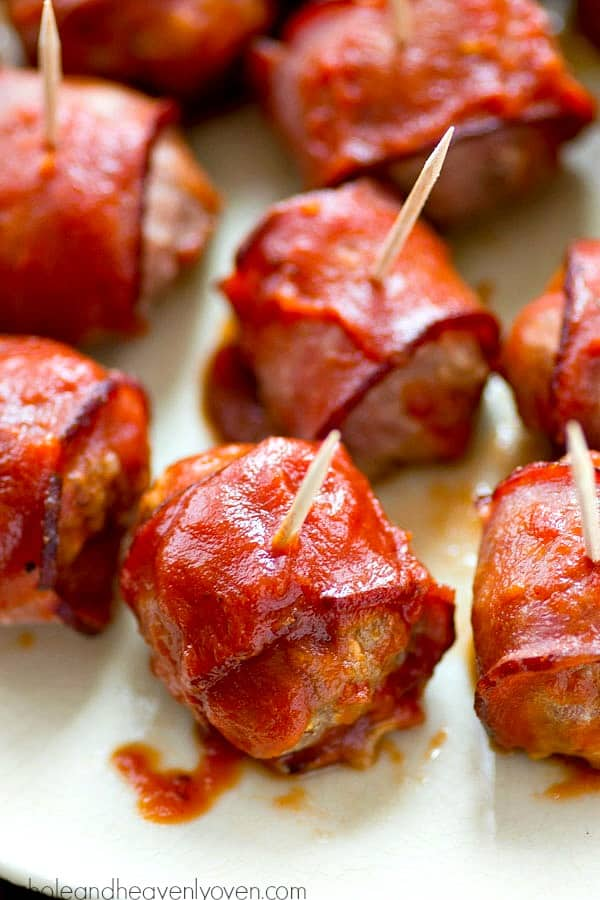 Healthier turkey meatballs made easy with minimal prep in the crockpot! Game-day guests will love the bacon and homemade BBQ sauce in these flavorful appetizer meatballs.