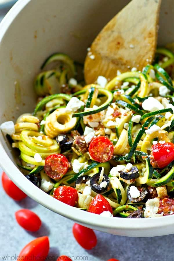 You won't be able to stop eating this flavorful zucchini noodles salad! Loaded with tons of fresh, healthy Mediterranean goodness and an unbelievable sun-dried tomato dressing.