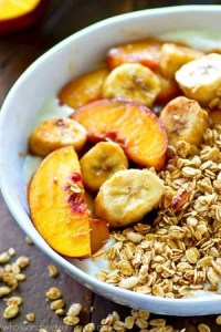 Ready for the ultimate power-packed summer breakfast? These granola yogurt bowls are piled high with warm caramel-y bananas and peaches and the EASIEST weekday breakfast ever!