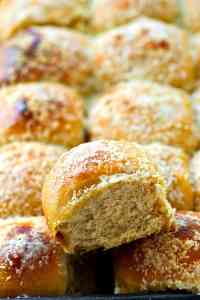 Fluffy mashed potatoes and lots of flavorful roasted garlic and Parmesan cheese give these pretty dinner rolls the most unmatchable fluffy texture and incredible flavor!