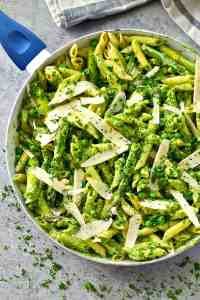 Ricotta cheese makes this flavorful pesto penne skillet SO creamy and the addition of sweet peas and asparagus make it an entire spring-style vegetarian dinner-in-one!
