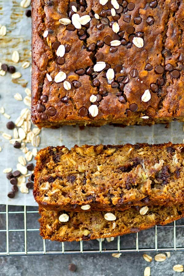 This super-moist loaded banana bread tastes like an oatmeal chocolate chip cookie and banana bread all rolled into one! Watch the entire loaf disappear before your very eyes.