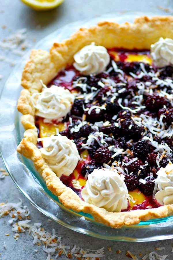 Layered with fresh blackberry sauce and a tangy homemade lemon curd, this twist on coconut cream pie is a gorgeous dessert for any occasion and the trio of flavors is mind-blowing!