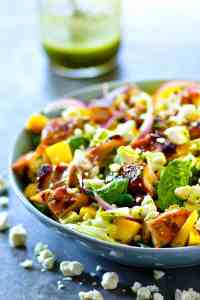 Sweet 'n' sticky grilled honey garlic chicken is a perfect match with sweet mango and flavorful cilantro dressing in this gorgeous grilled chicken mango salad!