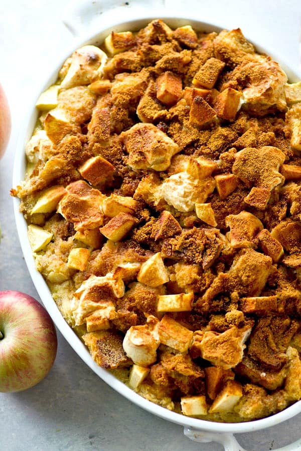 This apple cheesecake bread pudding is heavy on the fall flavors! Creamy dollops of cheesecake, tender apples, and a soft spiced bread pudding base make it completely irresistible.
