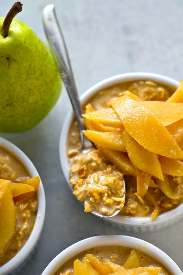 Creamy gingerbread overnight oats are piled high with soft caramelized pears and you'll never want your overnight oats any other way again this winter!