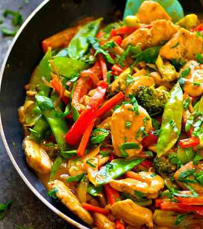 A savory peanut sauce covers every inch of this flavor-packed peanut satay chicken stir-fry! Load it up with all your favorite vegetables and pile it over hot fluffy rice.