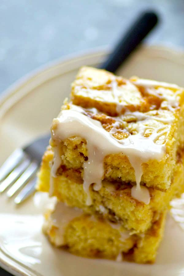 Soft, buttery sheet cake is swirled with a luscious cinnamon roll filling and then drenched in sweet glaze.--this is one addicting cinnamon roll sheet cake!