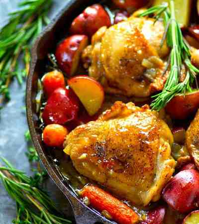 Incredibly juicy chicken is braised in a hearty beer sauce with lots of tender red potatoes and carrots! This beer braised chicken will quickly become a dinner staple.