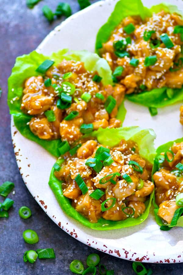 A sweet, sticky homemade sesame honey sauce coats EVERY inch of these loaded honey garlic chicken lettuce wraps! You can make them WAY ahead of time for easy lunches.