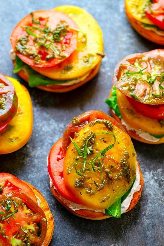 Creamy goat cheese and ULTRA-juicy heirloom tomatoes join forces and take these summery open-faced goat cheese bagel sandwiches to the next level!