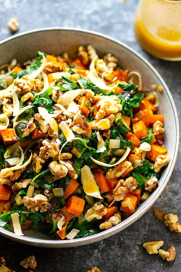 Warm Sweet Potato Kale Salad - Warm roasted sweet potatoes and tender sauteed kaleare tossed in a flavorful tahini dressing for a hearty sweet potato kale salad that's on the lighter side!